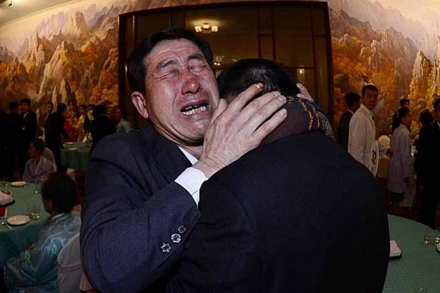 South Korean Park Yang Gon (right), 53, and his North Korean brother Park Yang Su cry during their family reunion at the Mount Kumgang resort in North Korea on Feb 20, 2014. -- PHOTO: REUTERS