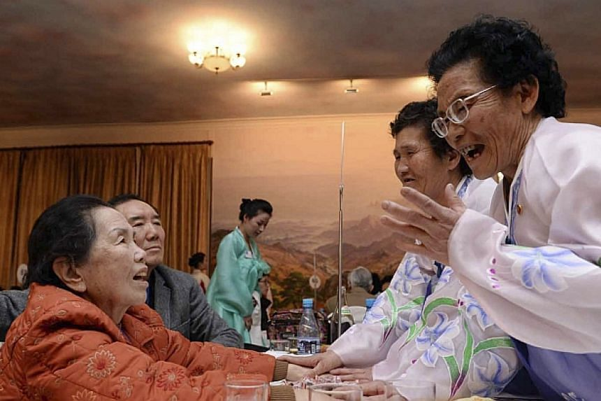 South Korean Lee Oh Hwa (left), 85, talks with her North Korean sisters during their family reunion at the Mount Kumgang resort in North Korea on Feb 20, 2014. -- PHOTO: REUTERS