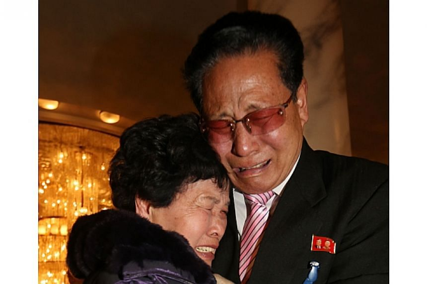 North Korean Lee Yun Geun (right), 72, hugs his South Korean sister Lee Sun Hyang, 88, during their family reunion at the Mount Kumgang resort in North Korea on Feb 20, 2014. -- PHOTO: REUTERS