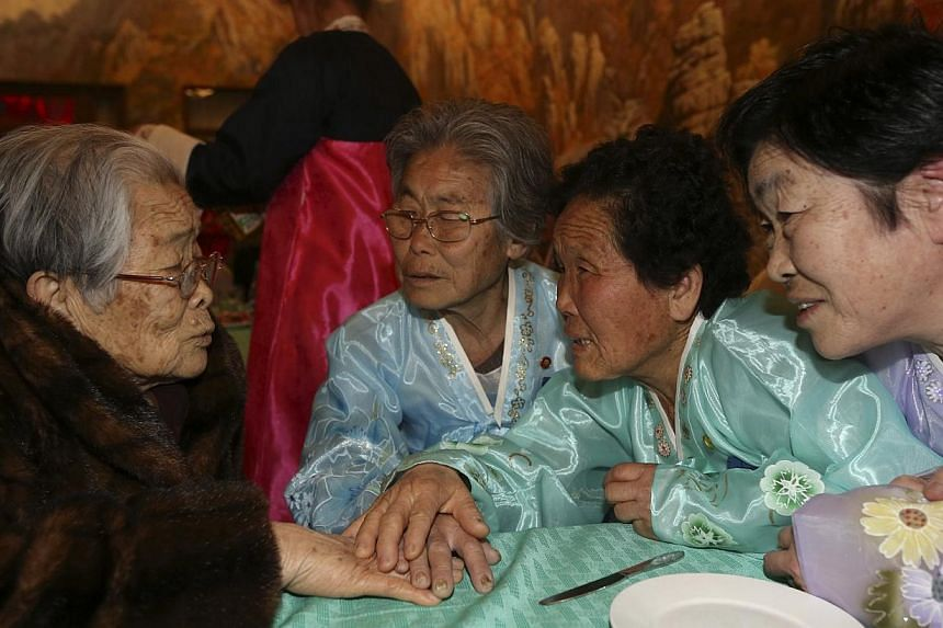 South Korean Kim Sung Yun (left), 96, talks with her North Korean sister Kim Seok Ryeo (second from left), 80, and family members during their family reunion at the Mount Kumgang resort in North Korea on Feb 20, 2014. -- PHOTO: REUTERS