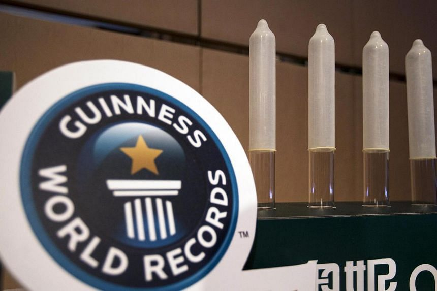 Guangzhou Daming United Rubber Products'sAONI condom. TheChinese manufacturer has set the record for the world's thinnest latex condom with one measuring 0.036mm, Guinness World Records said on Thursday, Feb 20, 2014. -- PHOTO: REUTERS