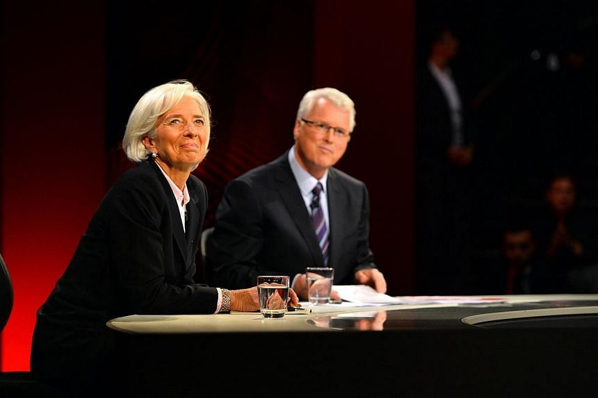 """IMF chief Christine Lagarde (left) said on Thursday that China was unlikely to suffer a hard landing, describing it as a """"poorly understood and poorly interpreted"""" economy that took a cautious approach to growth. -- PHOTO: AFP"""