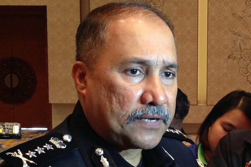 Johor police chief Mohd Mokhtar Mohd Shariff speaking about the Johor crime situation to Singaporean and Malaysian media in Johor Bahru on Thursday. -- ST PHOTO: YEO SAM JO