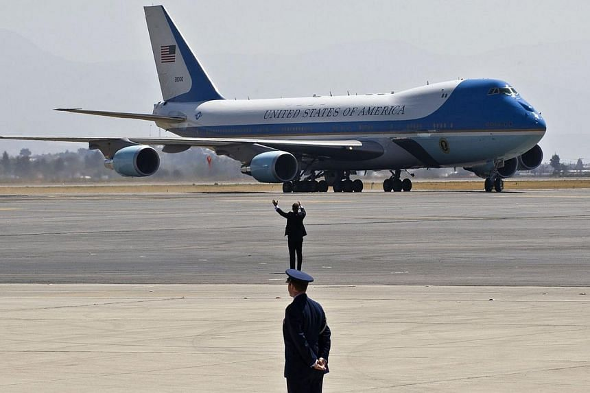 Air Force One, with United States President Barack Obama on board, lands in Toluca, Mexico, on Feb 19, 2014. See more pictures from around the world in Through The Lens' Today in Pictures. -- PHOTO: AFP