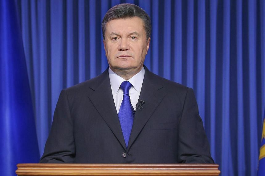 Ukraine's President Viktor Yanukovych speaks in Kiev on Feb 19, 2014, during his address to the nation. Ukrainian President Viktor Yanukovych on Wednesday announced a truce and the start of direct talks with the opposition after holding private talks