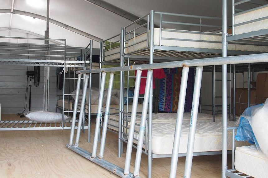Bunk beds under assembly at Australia's regional processing centre on Manus Island in Papua New Guinea on Feb 18, 2014. An investigation into deadly clashes this week at an immigration detention centre in Papua New Guinea will examine possible miscon
