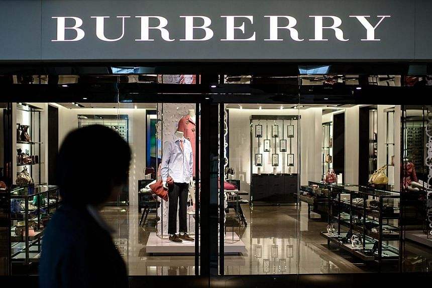 A woman walks past a Burberry store in Hong Kong on February 21, 2014. A brazen shoplifter has helped himself to an alligator-leather coat worth nearly HKD1 million (USD130,000) from a flagship Burberry store in one of Hong Kong's busiest shopping di