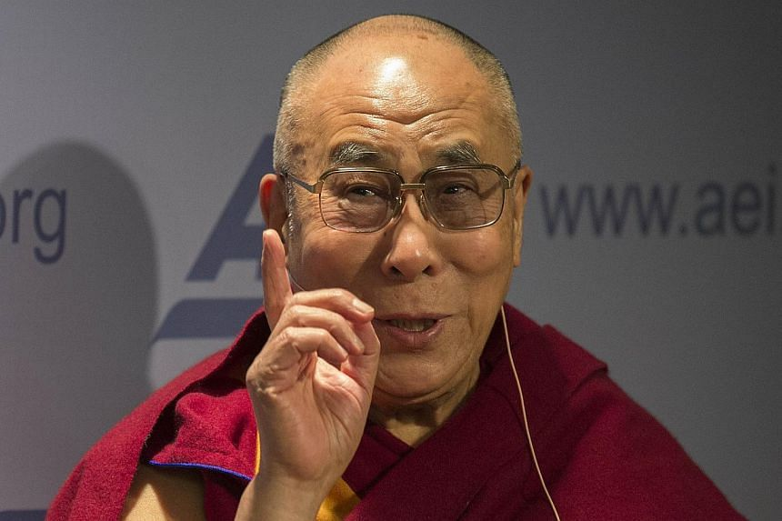 "The Dalai Lama speaks at the American Enterprise Institute (AEI) during a panel discussion on ""Happiness, Free Enterprise, and Human Flourishing"" in Washington, DC, on Feb 20, 2014. President Barack Obama will meet Tibet's exiled spiritual leader at"