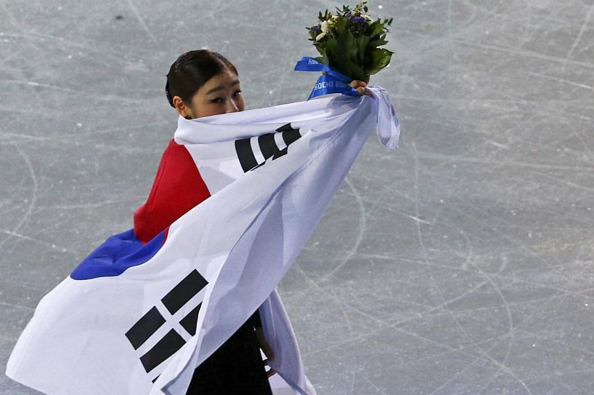 For millions of South Koreans who stayed up into the early hours of Friday morning to watch their idol Kim Yu Na try to defend her Olympic figure-skating title, there was heartbreak and anger over her eventual silver finish. -- PHOTO: REUTERS