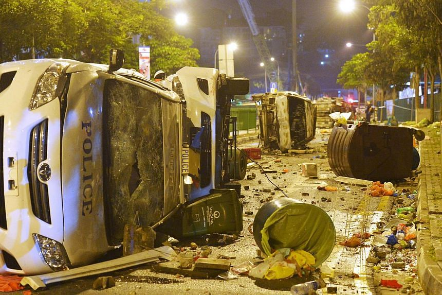 The aftermath of the riot in Little India's Race Course Road and Buffalo Road on Dec 9, 2013. -- ST FILE PHOTO: ALPHONSUS