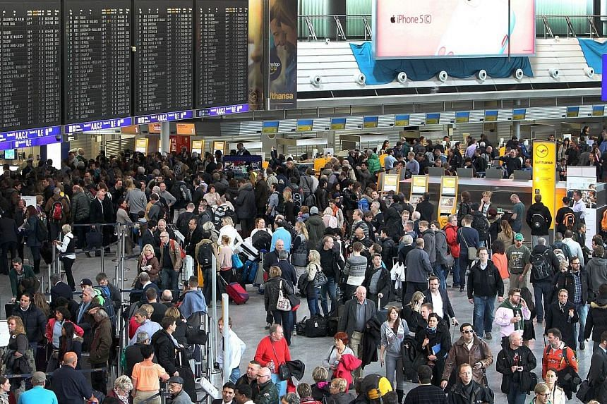 Passengers are waiting at the airport in Frankfurt am Main, central Germany, due to a strike of security staff on Feb 21, 2014.-- PHOTO: AFP