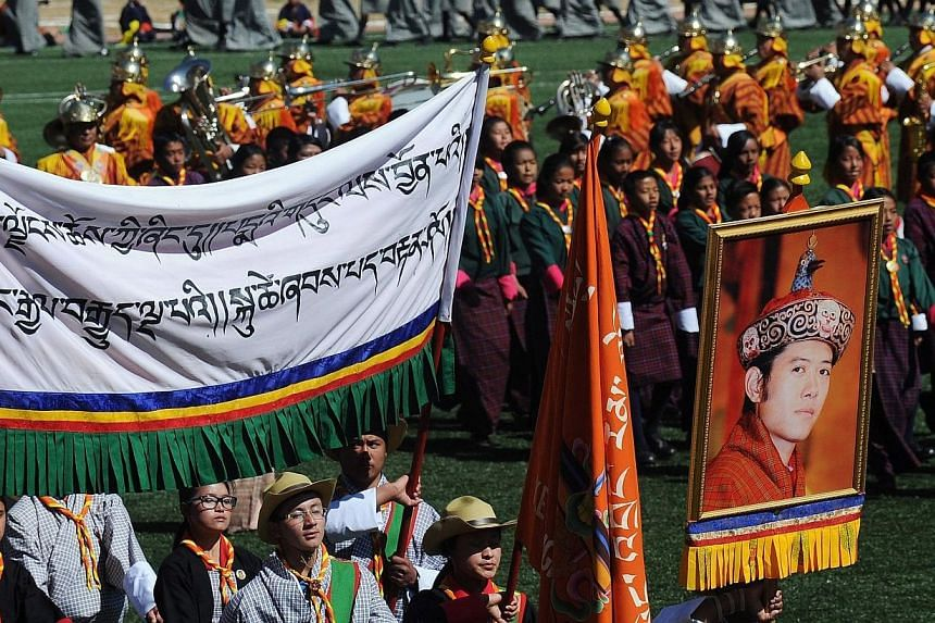 Bhutanese students participate in celebrations marking the Bhutanese King Jigme Khesar Namgyel Wangchuck's 34th birthday at the National stadium in Thimphu on Feb 21, 2014. The tiny Himalayan kingdom of Bhutan on Friday, Feb 21, 2014, celebrated