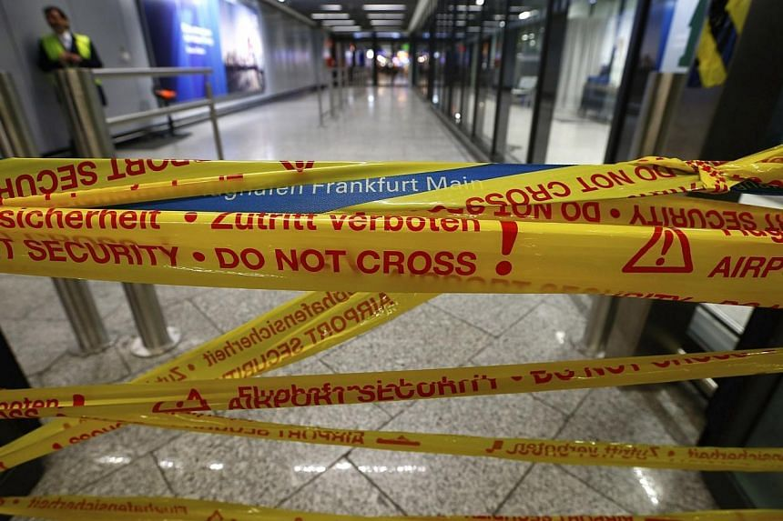 Security gates are closed during a strike in Frankfurt airport, Feb 21, 2014. -- PHOTO: REUTERS