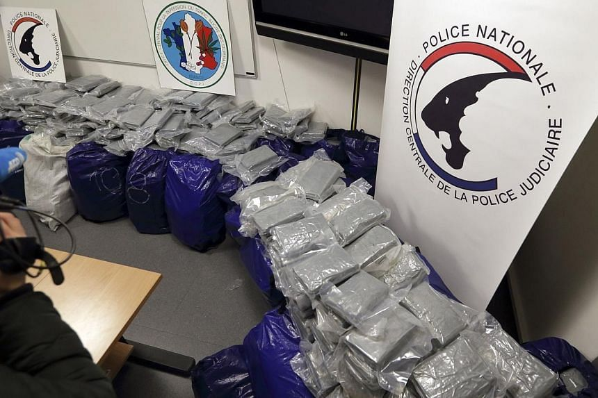 Part of the1.4 tonnes of cocaine seized by police with a value of 270 million euros(S$470 million) at Le Havre harbour on Feb 12, 2014 is displayed at police headquarters in Nanterre. -- PHOTO: REUTERS