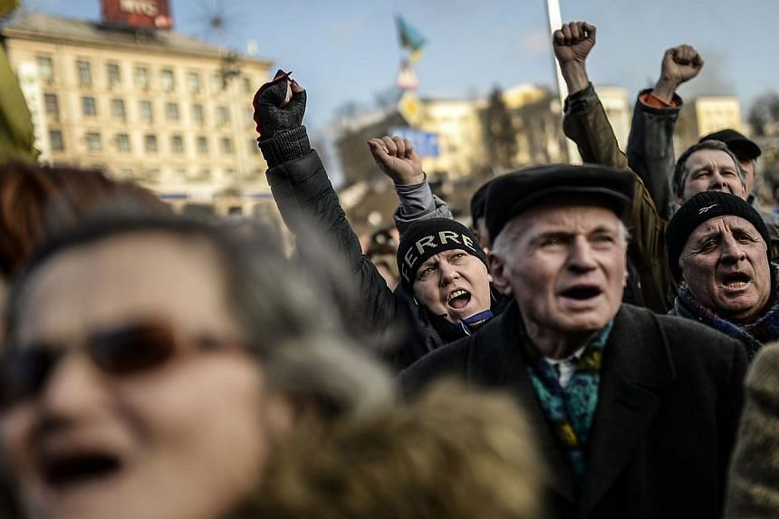 Anti government protesters chant slogans on Independence square on Feb 21, 2014 in Kiev.Ukraine's leader and opposition on Friday, Feb 21, 2014, signed a deal to end the splintered country's worst crisis since independence after three days of c