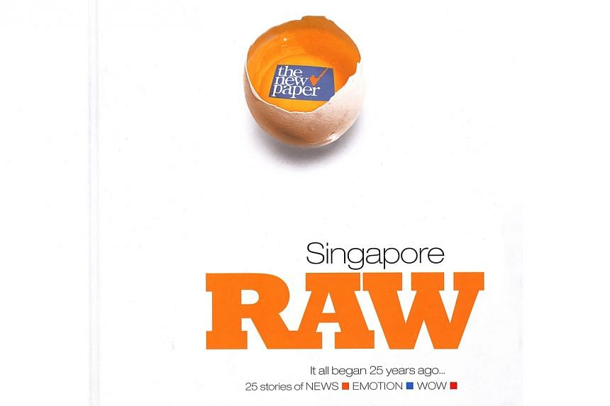 """The New Paper has launched a coffee table book titled """"Singapore Raw: 25 stories from 25 years of news, emotion, wow"""" in commemoration of its 25th anniversary. -- ST PHOTO"""