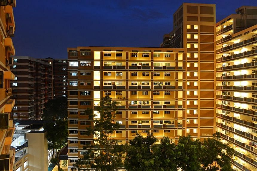 About 800,000 Singapore households living in Housing Board flats will benefit from a one-off GST voucher payment to help offset utility bills. -- ST FILE PHOTO:CAROLINE CHIA
