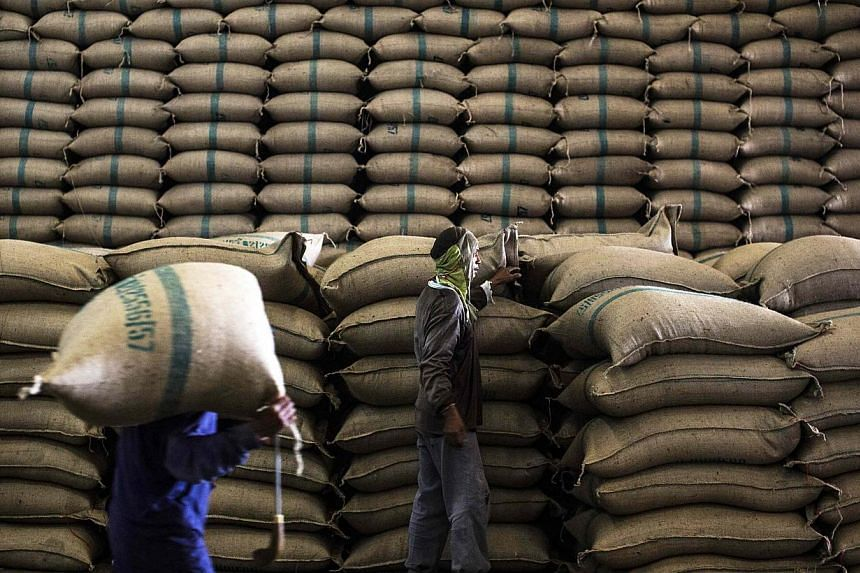 Workers at the Udon Permsin rice mill carry sacks full of rice to store in the northeast province of Udon Thani, Thailand on Jan 21, 2014. Singaporeans switched to other sources of rice last year when Thai rice prices rose on the back of tighter supp