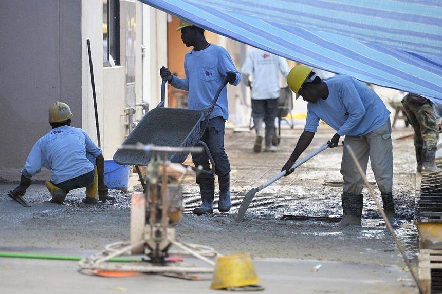 Construction workers in Chai Chee on Jan 14, 2014. The levy on foreign construction workers with only basic skills will go up from $600 per worker to $700 in July 2016, said Finance Minister Tharman Shanmugaratnam. -- ST FILE PHOTO: MATTHIAS HO