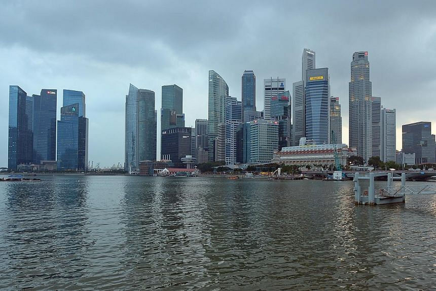 The Singapore Government is expected to record an overall surplus of $3.9 billion for financial year 2013, higher than the surplus of $2.4 billion budgeted a year ago. -- ST FILE PHOTO: DESMOND WEE
