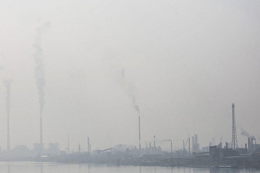 Petrochemical plants are seen in Nanjing, Jiangsu province, Feb 20, 2014. -- PHOTO: REUTERS
