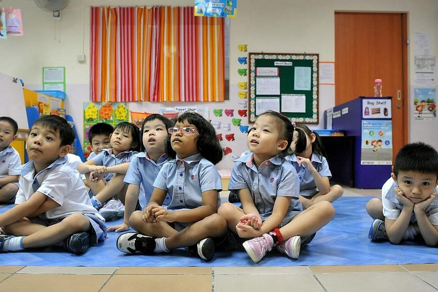 Pupils attending a Chinese reading lesson at the PAP Community Foundation Teck Ghee kindergarten on July 27, 2012. The Government will provide more support to defray the education costs of lower-income households, Deputy Prime Minister and Finance Mi