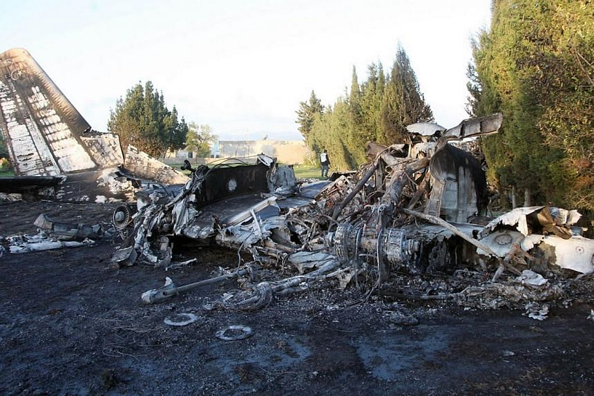 A picture taken on Feb 21, 2014 shows the wreckage of a Libyan army medical plane that crashed in the Grombalia area, 40 kilometres (25 miles) south of the Tunisian capital, Tunis, killing all 11 people on board. -- PHOTO: AFP