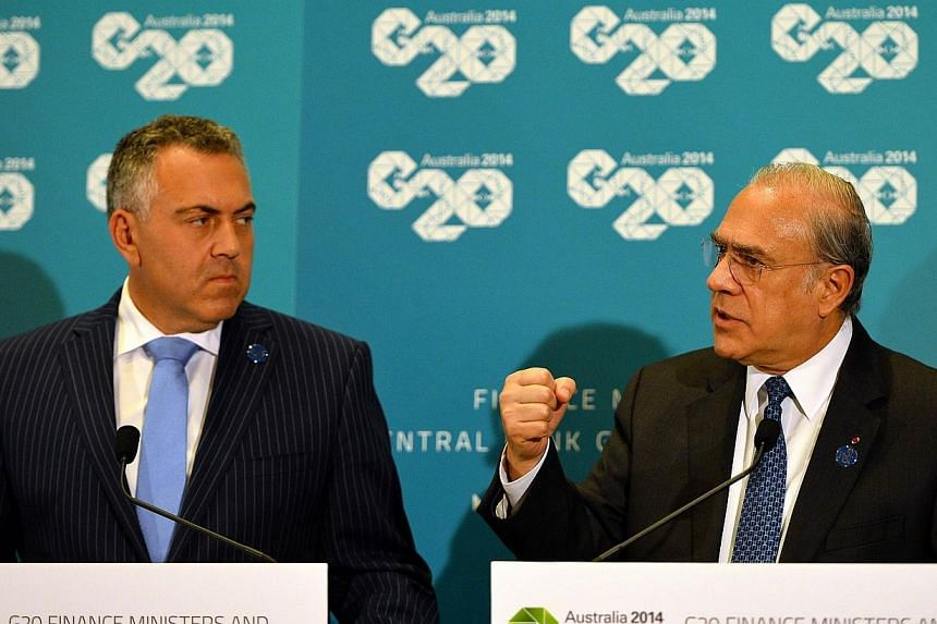 Angel Gurria (right), Secretary-General of the Organisation for Economic Co-operation and Development speaks at a joint press conference with Australia Treasurer Joe Hockey at the G20 Finance Ministers and Central Bank Governors meeting in Sydney on