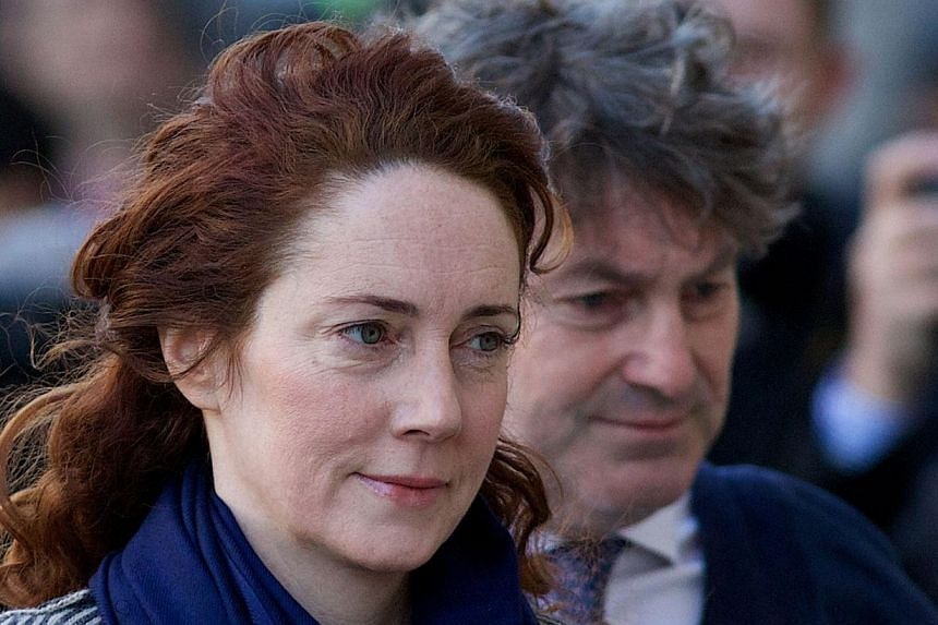 Rebekah Brooks, the former boss of Rupert Murdoch's British newspapers, denied having a six-year affair with fellow editor Andy Coulson but said they did have periods of physical intimacy over a number of years. -- PHOTO: AFP