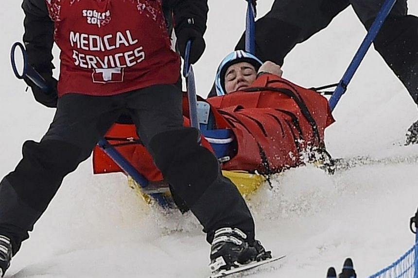 Germany's Anna Woerner is carried off course by medical staff following a fall during the women's freestyle skiing skicross quarter-finals at the 2014 Sochi Winter Olympic Games in Rosa Khutor, on Friday, Feb 21, 2014. German Anna Woerner suffer
