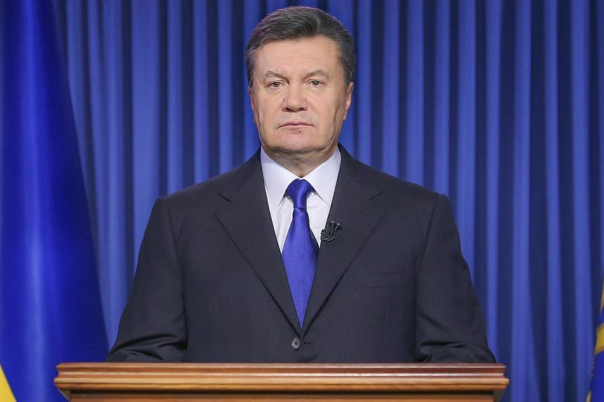 Ukraine's President Viktor Yanukovych speaks in Kiev on Feb 19, 2014, during his address to the nation. -- PHOTO: AFP
