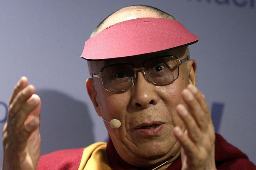 The Dalai Lama addresses the American Enterprise Institute in Washington on Feb 20, 2014. China on Feb 21, 2014 urged United States President Barack Obama to cancel a planned meeting with the exiled Tibetan spiritual leader. -- PHOTO: REUTERS