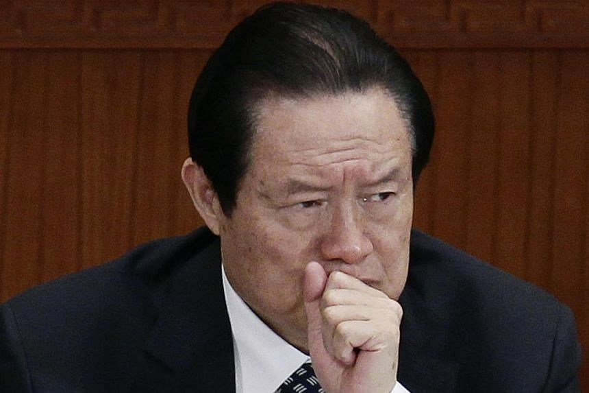 Former Chinese Politburo Standing Committee Member Zhou Yongkang at the second plenary meeting of the National People's Congress in Beijing on March 8, 2012. Chinese investigators have questioned more than a dozen senior officials, including the coun