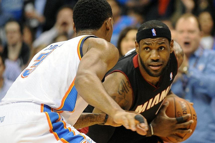 Miami Heat small forward LeBron James (6) handles the ball against Oklahoma City Thunder small forward Perry Jones (3) during the second quarter at Chesapeake Energy Arena, on Feb 20, 2014. -- FILE PHOTO: REUTERS