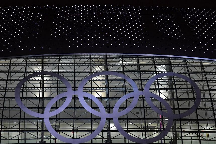 The Olympic rings and the final score is displayed on the Bolshoy Ice Dome at the end of the Men's Ice Hockey Semifinals USA vs Canada at the during the Sochi Winter Olympics on Feb 21, 2014. -- PHOTO: AFP
