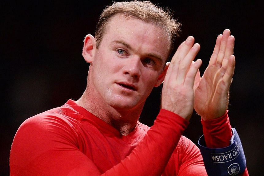 Wayne Rooney pledged his long-term future to Manchester United on Friday after signing a blockbuster contract extension with the Premier League champions. -- FILE PHOTO: AFP