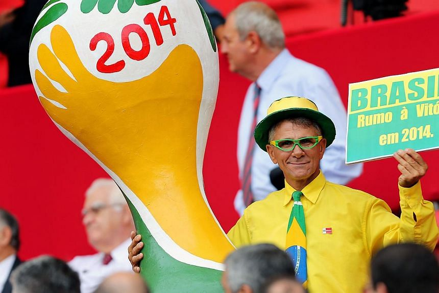 A supporter of Brazil poses during the opening of the brand new Beira Rio Stadium during the 2014 FIFA World Cup Host City Tour, on Feb 20, 2014 in Porto Alegre, Brazil. A total of 2.3 million tickets have been sold for the World Cup's 64 matche