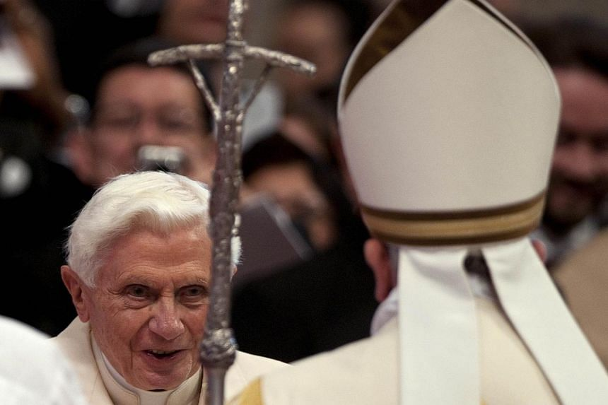 Pope Francis (right) greets former Pope Benedict during a consistory ceremony in Saint Peter's Basilica at the Vatican, Feb 22, 2014..-- PHOTO: REUTERS