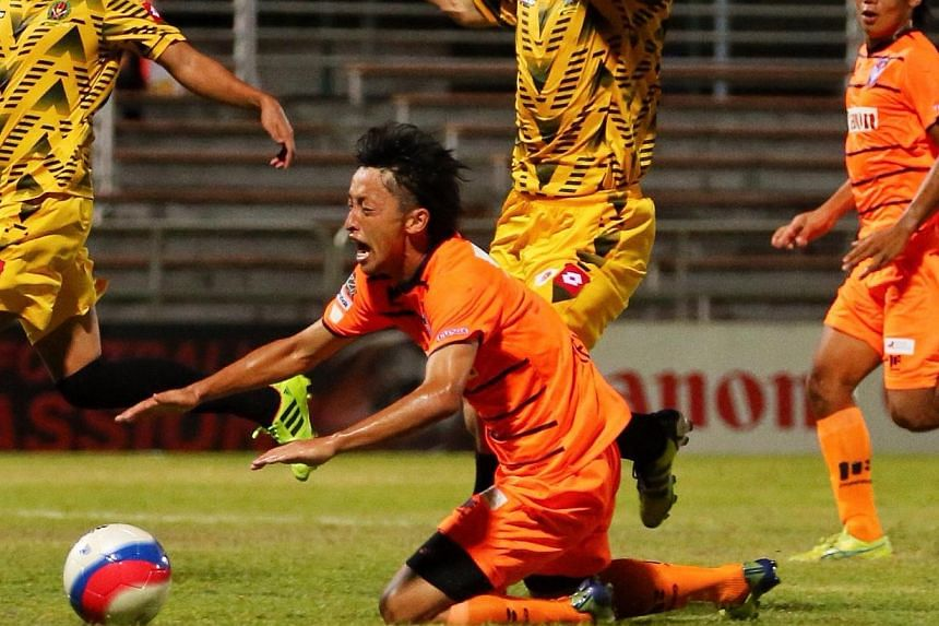 Brunei DPMM defender Boris Raspudic's (centre, in yellow) challenge on Albirex Niigata's Keisuke Ota in the penalty area went unpunished by referee Ahmad A'Qashah. Brunei DPMM defeated Albirex Niigata 1-0 in a Great Eastern-Yeo's S-League match at th