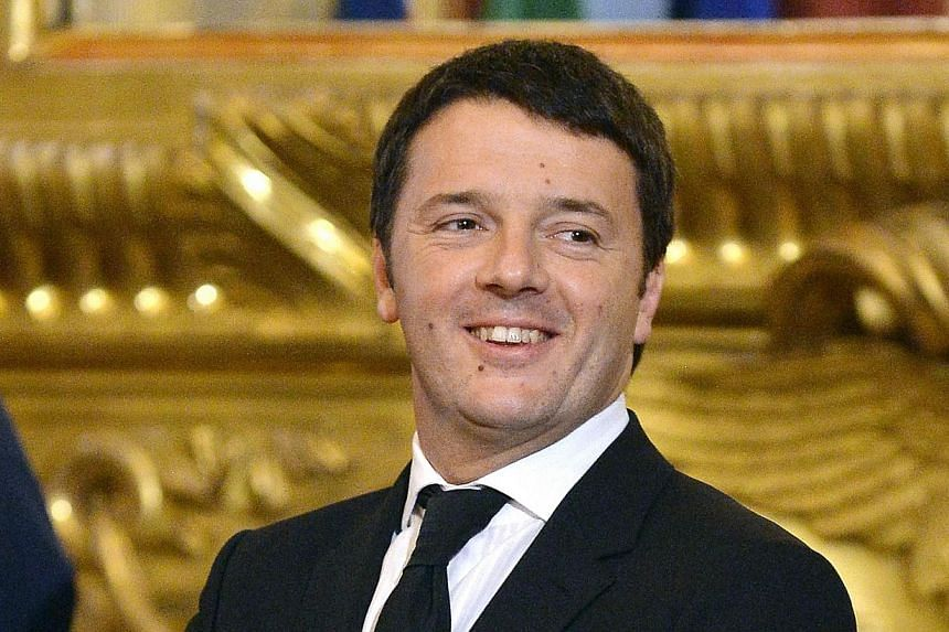 Italian Prime Minister Matteo Renzi smiles during the swearing in ceremony on Feb 22, 2014 at Quirinale Palace in Rome. MrRenzi and his fresh-faced cabinet were sworn in on Saturday, Feb 22 ,2014, amid widespread scepticism that the new governm