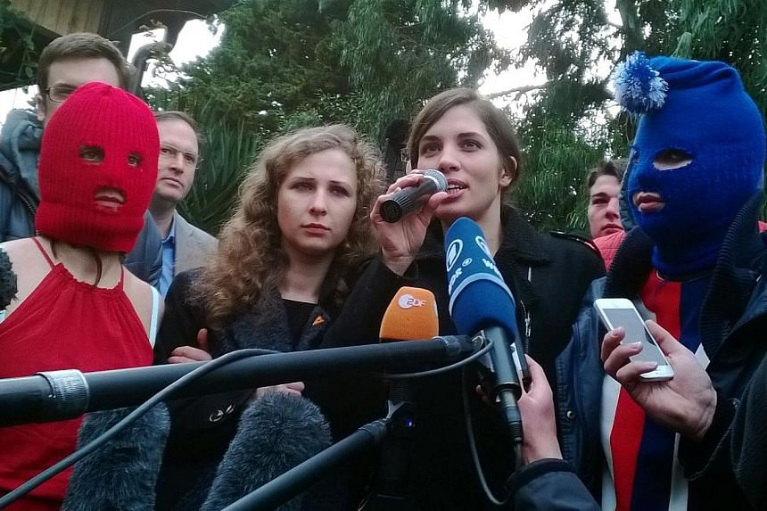 Nadezhda Tolokonnikova (right) and Maria Alyokhina speak to the press with fellow Russian punk group Pussy Riot members on Feb20, 2014 in Sochi, after posted a new video filmed in the centre of Olympics host Sochi, savaging Russian President Vl
