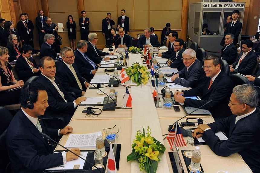 Trade ministers and representatives attend the Trans-Pacific Partnership (TPP) Ministerial Meeting in Singapore on Feb 22, 2014.Asia Pacific trade ministers began a fresh round of talks in Singapore on Saturday, Feb 22, 2014, for a huge US-led