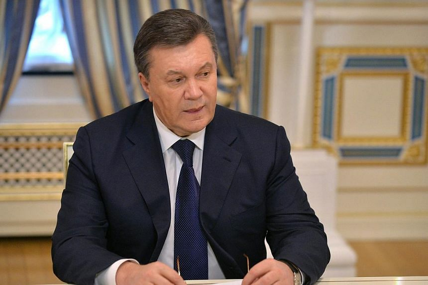 Ukrainian President Viktor Yanukovych looks on before signing an agreement in Kiev on Feb 21, 2014 to end the splintered country's worst crisis since independence after three days of carnage left nearly 100 protesters dead and the heart of Kiev resem