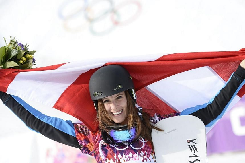 Gold Medallist, Austria's Julia Dujmovits celebrates at the Women's Snowboard Parallel Slalom Flower Ceremony at the Rosa Khutor Extreme Park during the Sochi Winter Olympics on Feb 22, 2014.