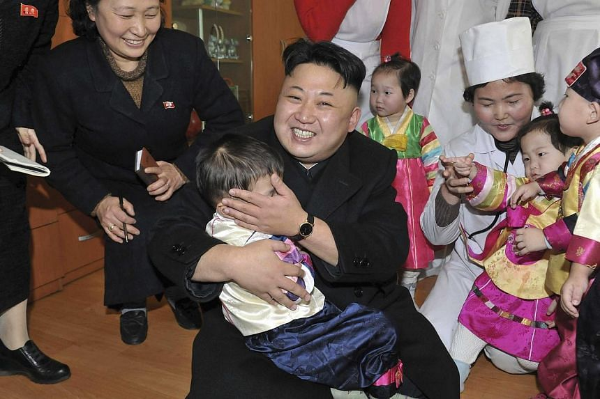 """North Korean leader Kim Jong Un visits an orphanage in this undated photo released by North Korea's Korean Central News Agency (KCNA) in Pyongyang in Feb4, 2014.North Korea on Friday, Feb 21, 2014, """"categorically"""" rejected a United Nations repo"""