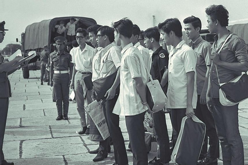 Youth reporting for national service on Aug 30, 1967. Singapore's first NS batch will receive health-care benefits in the Pioneer Generation Package.