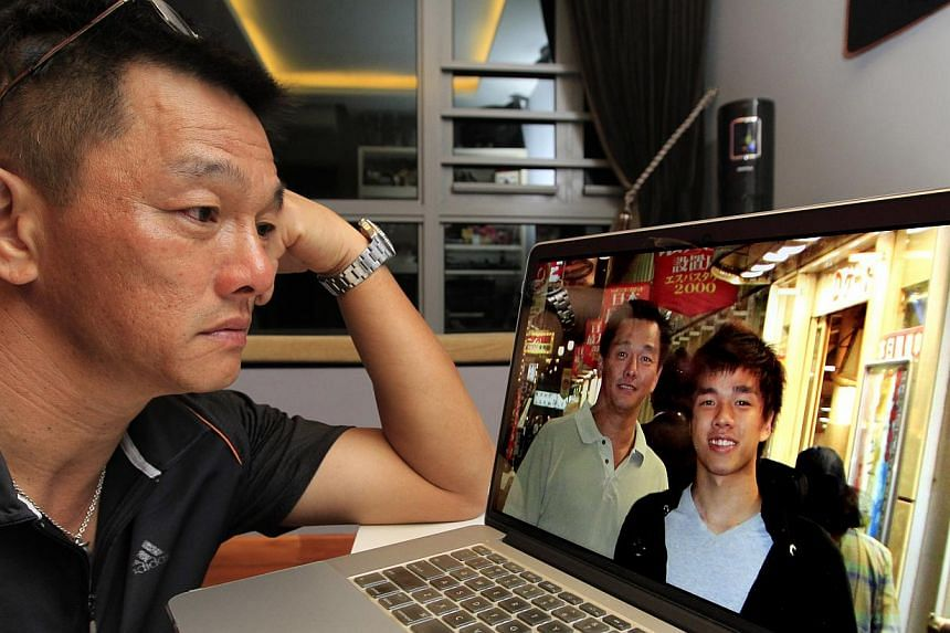 """Mr Francis Ng looking at a photo of himself with Darren in happier times. Mr Ng, who is organising a golf tournament to raise funds for troubled teens, said: """"I had already lost my son. I didn't want other parents to lose theirs.""""  Mr Francis Ng (rig"""