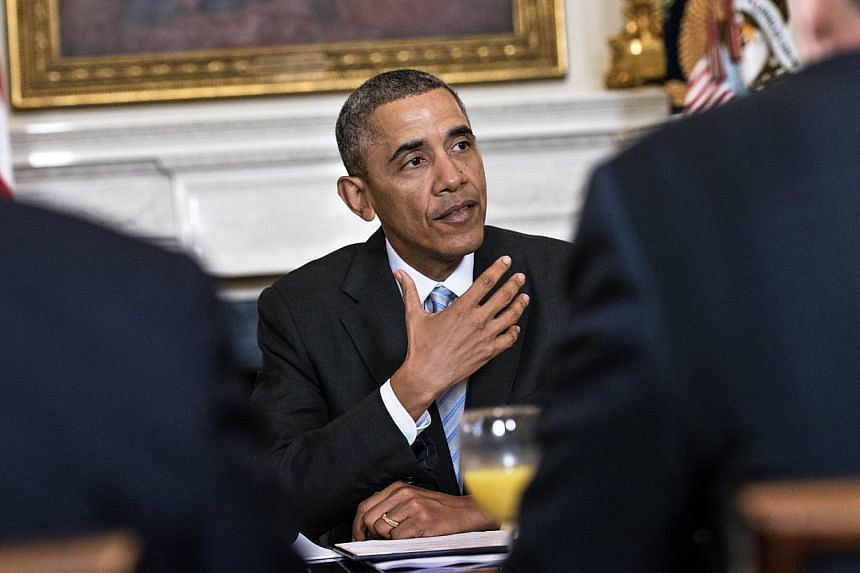 US President Barack Obama will confer the most prestigious US award for combat to a group of Hispanic, black and Jewish veterans previously denied the accolade due to prejudice, the White House said. -- PHOTO:AFP