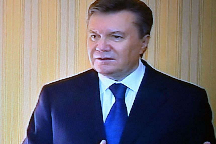 A handout TV screen grab provided by the Presidential Press Service shows Ukrainian President Viktor Yanukovych speaking to the local TV in Kharkiv on Feb 22, 2014. Mr Yanukovych said on February 22 he would not sign any of the new laws passed by Par