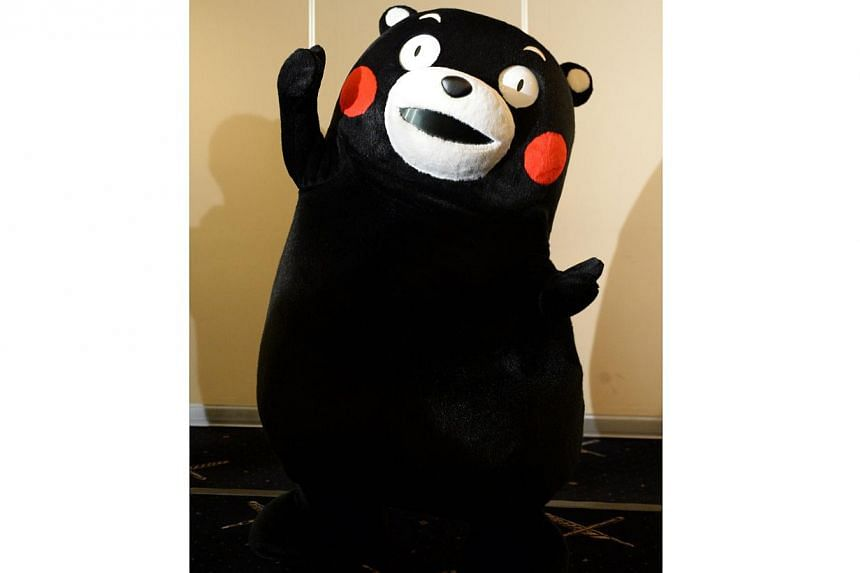 The life-sized Kumamon and his now nationally ubiquitous image - red cheeks and doughy physique - are found on everything from pastries and keychains to airplanes and purses. -- PHOTO: AFP